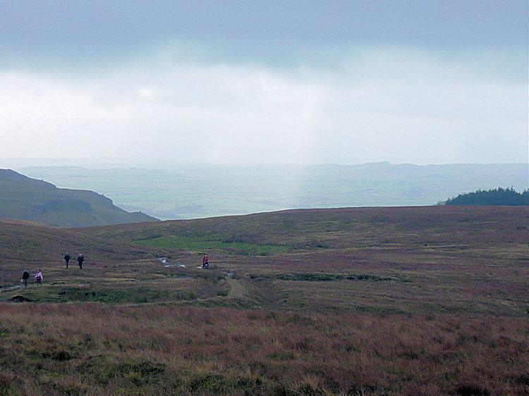 Walkers climbing Ingleborough from Gaping Gill