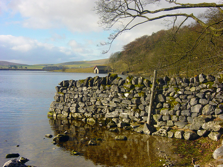 Drystone wall terminating in Malham Tarn