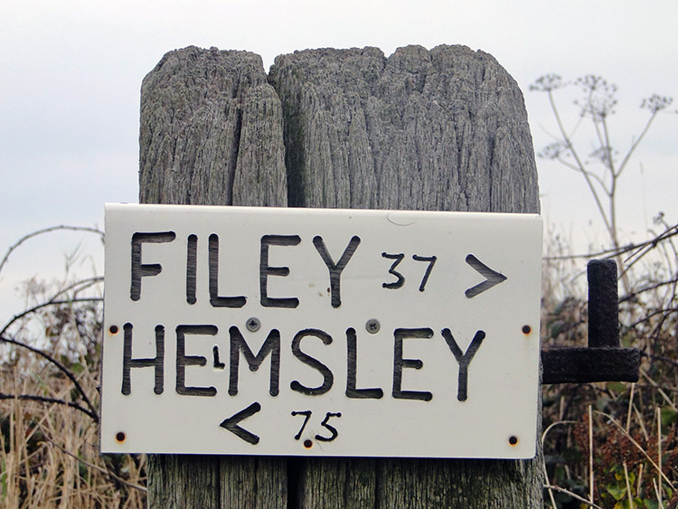 A Cleveland Way milepost sign