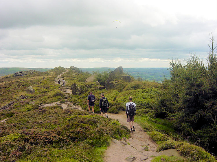Walkers in a line on the Roaches ridge path