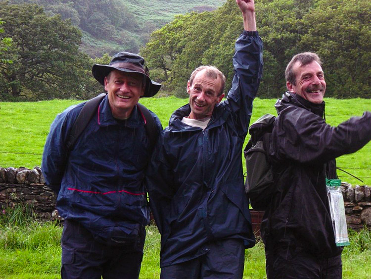 Wet and smiling walkers at Llyn Dinas