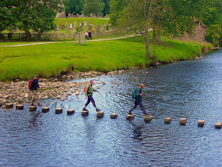 Crossing the River Wharfe by stepping stones