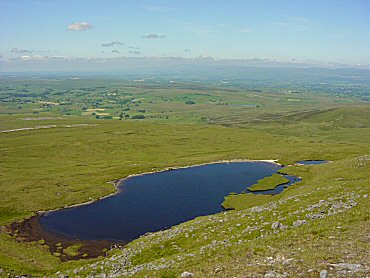 Sand Tarn hides just below the top of Wild Boar Fell