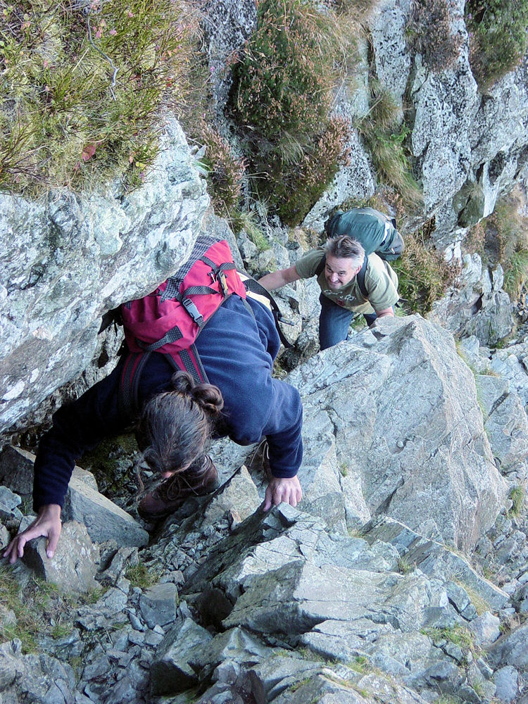 Deke and Spud climb up the narrow groove