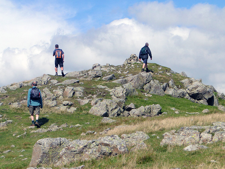 Scaling the short rocky path to Calfhow Pike