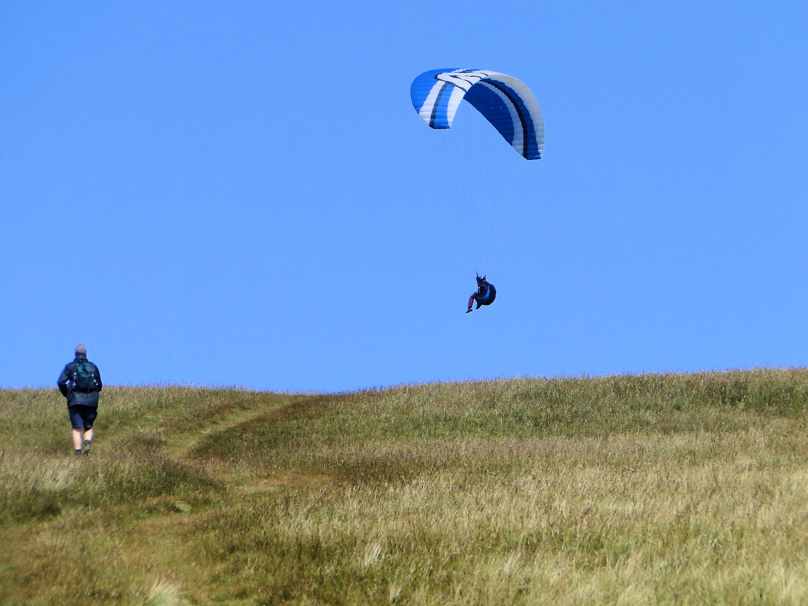 Steve observes a paraglider on Clough Head