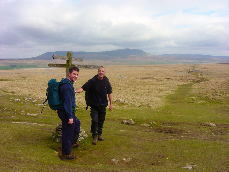 Paths cross at Sulber, Pen-y-ghent towers behind