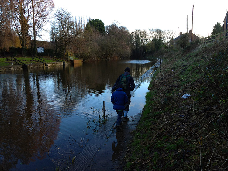 Wading through the riverside path at Milby Cut